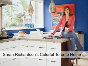 Sarah Richardson sitting on kitchen countertop