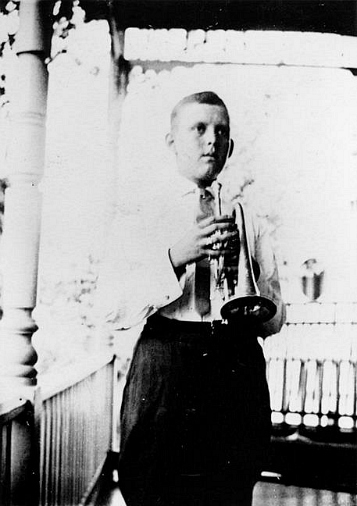 Rochester Gorham Wilkins plays trumpet on the front porch