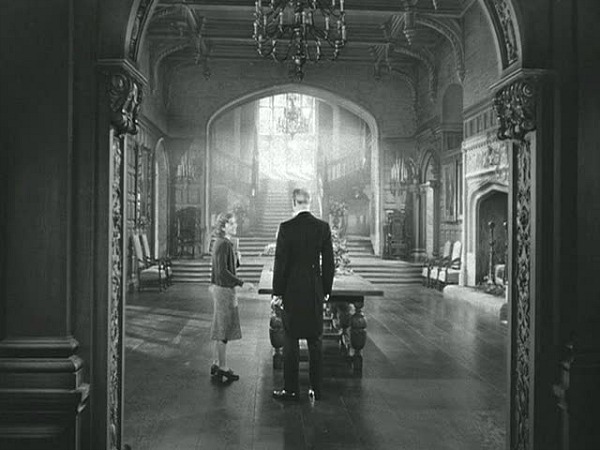 Joan Fontaine in Manderley's Great Hall Rebecca