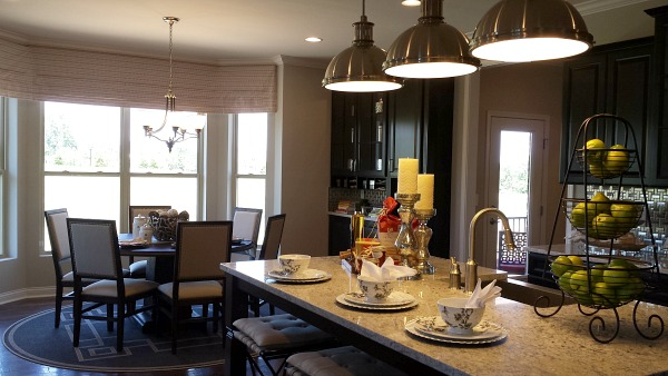 kitchen with black cabinets in model home