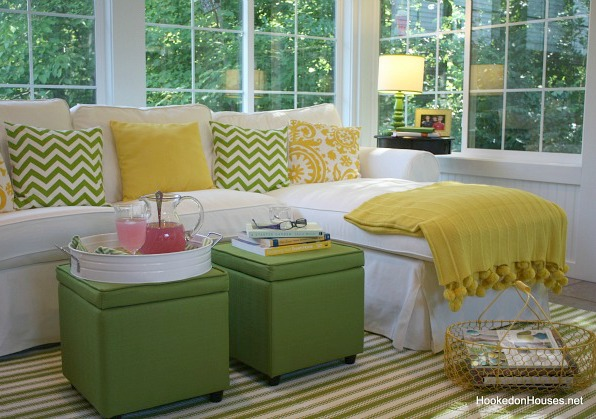 Ektorp sofa in the sunroom with green ottomans