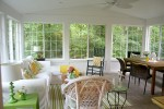 sunroom with vaulted ceiling and ceiling fan
