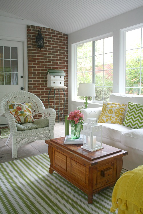 wicker chair and birdhouse in sunroom