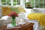 closeup of green Ball jar with flowers on cedar chest in sunroom