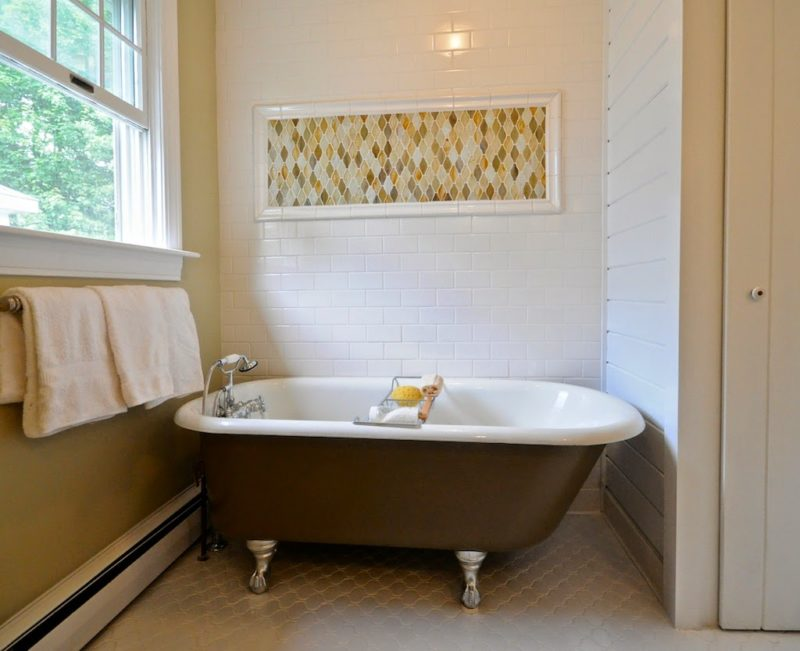 A large tub next to a window