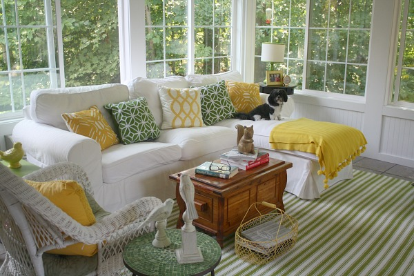 green and yellow pillows on the Ektorp sofa