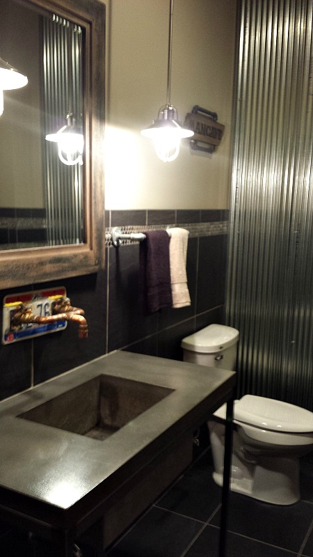 industrial looking bathroom in lower level