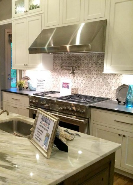 kitchen with stainless steel range and vent hood