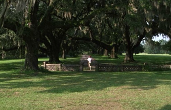 Forrest Gump runs down the lane in front of his house