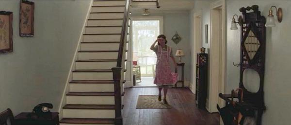 Mama Gump walks through entry hall of house