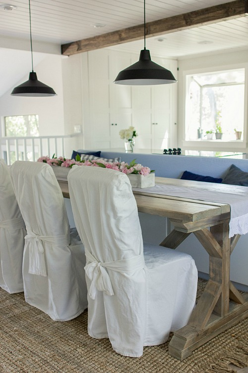 kitchen table with bench and slipcovered chairs