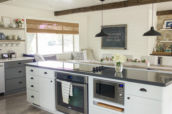 kitchen with white cabinets and beamed ceiling