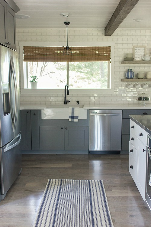 Jenna Sue\'s kitchen after makeover with blue gray cabinets and white subway tile