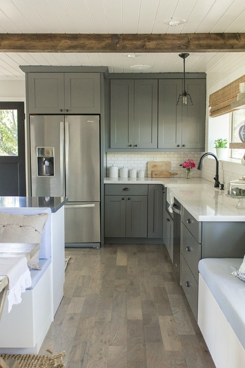 kitchen with gray cabinets and white subway tile