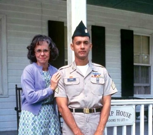 Sally Field and Tom Hanks stand in front of porch at Gump house