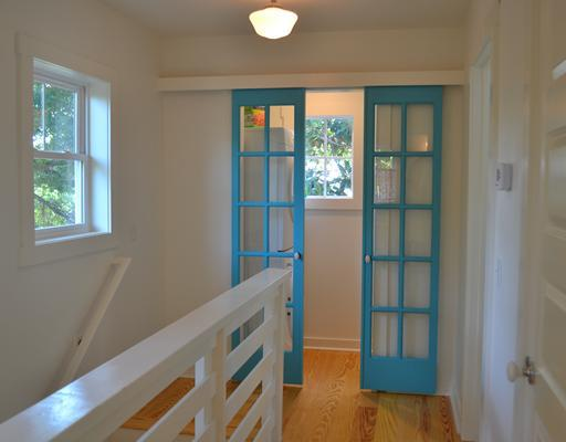 double doors painted teal leading to laundry room