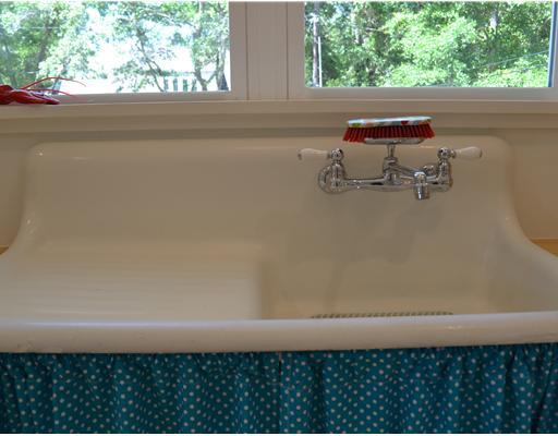 kitchen sink with teal fabric skirt