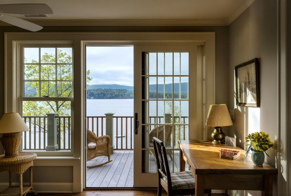 french doors open with view of the lake