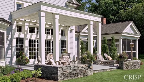 covered patio on back of modern farmhouse