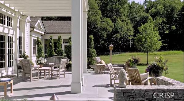 large stone patio behind house