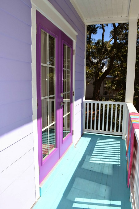 french doors painted purple on balcony of beach house