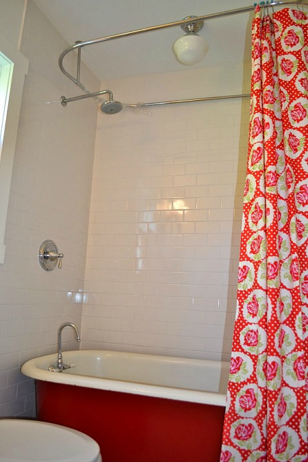 A shower with shower curtain