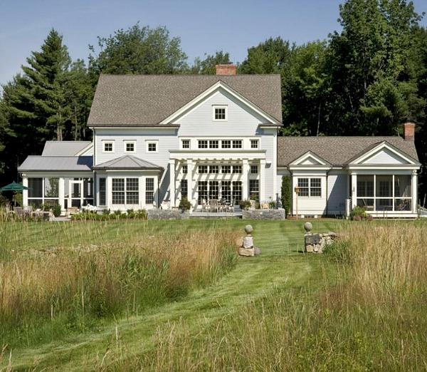 back exterior of large modern farmhouse