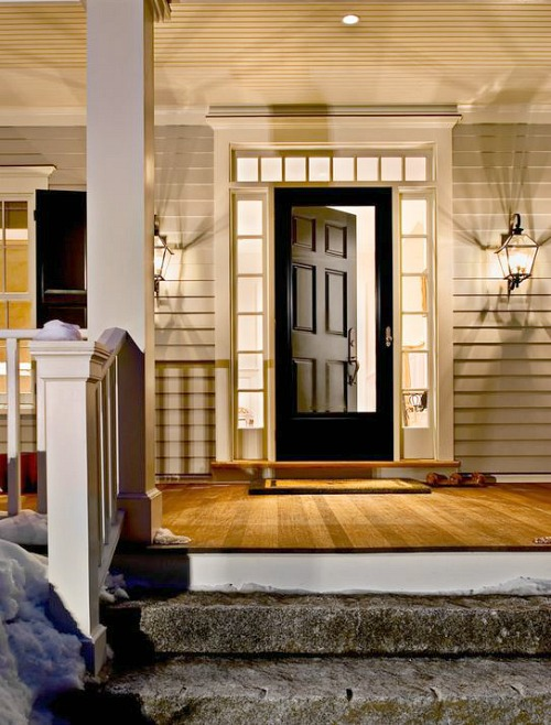 open front door on farmhouse porch