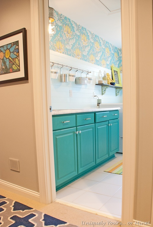 susan's laundry room teal cabinets