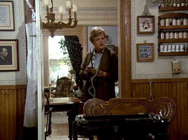Angela Lansbury leaning against kitchen doorframe