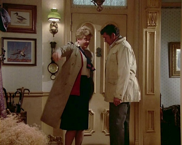 Angela Lansbury standing inside front door of her house on Murder She Wrote