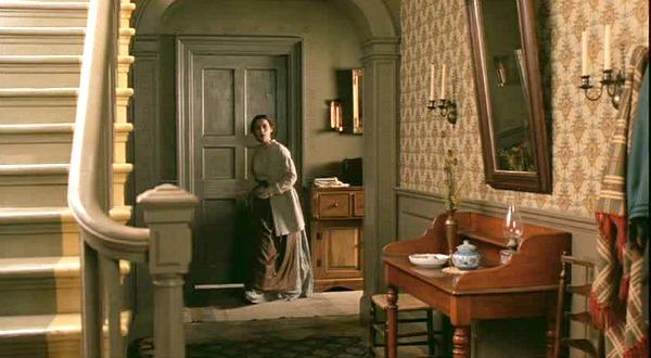 Winona Ryder walking along upstairs landing