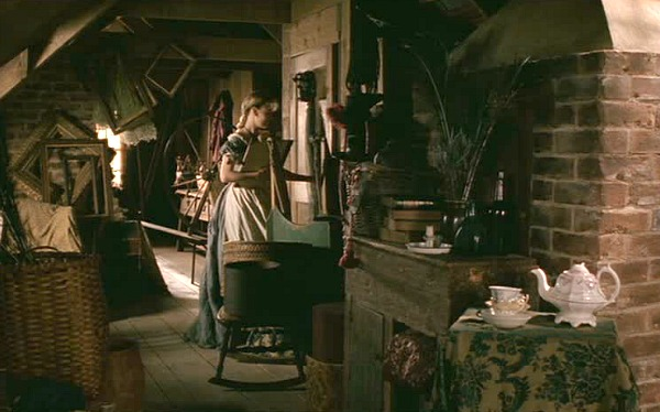 Amy March walks through a door in the attic