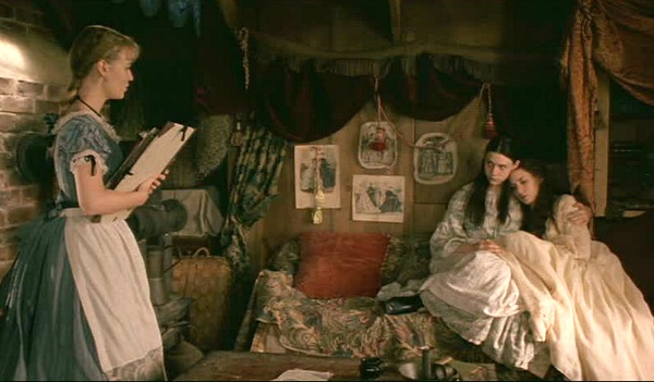 sisters talking in the attic of Orchard House in Little Women