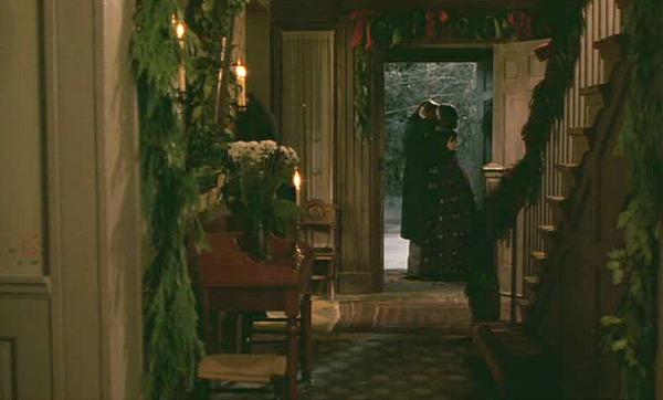 couple embracing in the open doorway