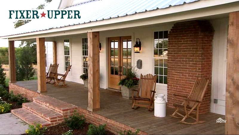 front porch of Chip and Joanna's farmhouse in Waco with Fixer Upper logo inset