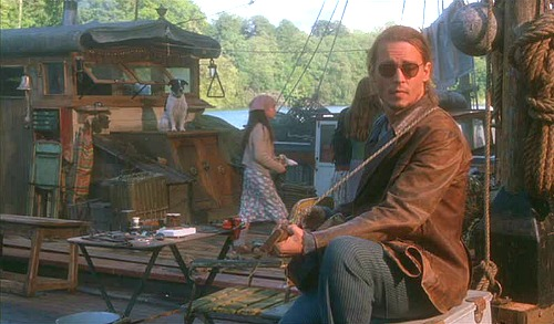Johnny Depp playing guitar on houseboat
