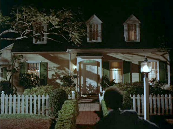 Cape Cod house from Mr. Mom movie at night with lights on