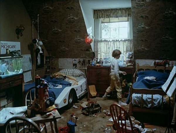 boy\'s bedroom with racing car bed