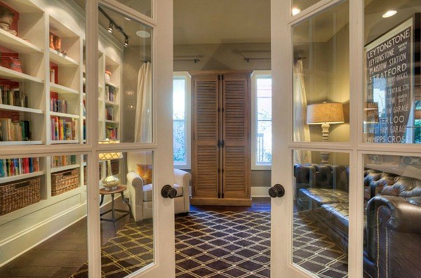 french doors leading to study with bookshelves