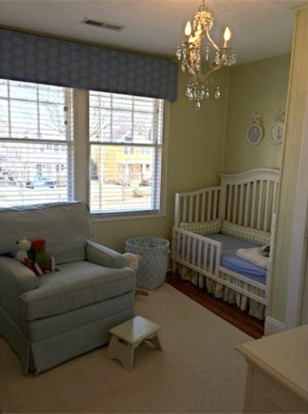 nursery with crib and glider rocker
