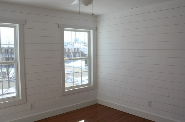 bedroom with shiplap and hardwood floors installed | hookedonhouses.net