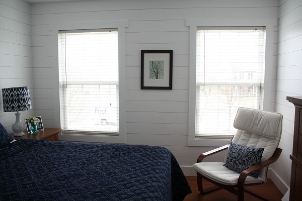 corner of bedroom with fake shiplap on wall