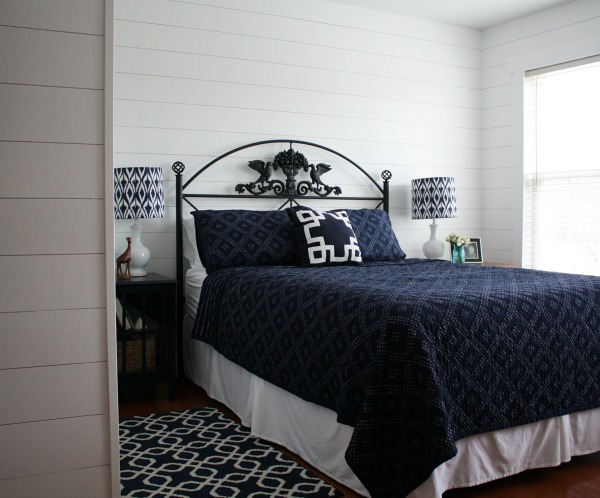blue and white bedroom with fake shiplap on walls