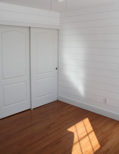 closet wall of small bedroom after hardwoods