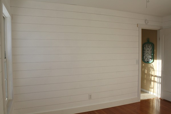 shiplap hung and painted white in bedroom