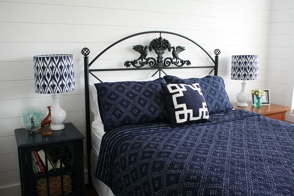 faux shiplap on wall of bedroom with queen size bed