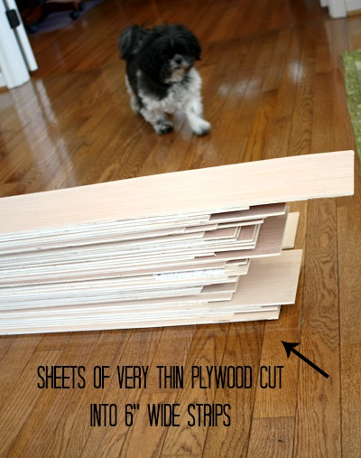 "Strips of plywood cut into 6"" strips for shiplap 