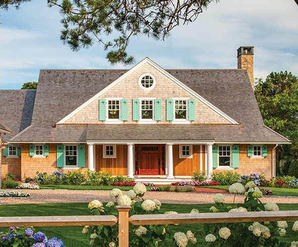 front exterior of shingle style beach house with aqua shutters