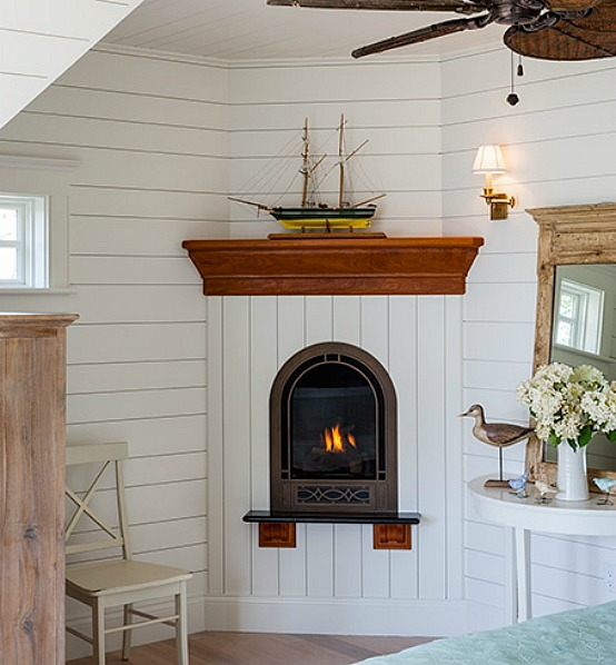 Sweet little bedroom fireplace in Cape Cod home